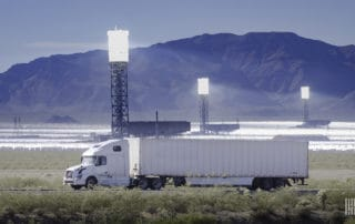Truck in front of the Ivanpah Solar Electric Generating System, Mojave Desert, California